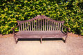 Old, English bench in the garden Royalty Free Stock Photo