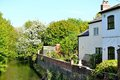 old English cottage on the river Royalty Free Stock Photo