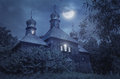 Old European church in a full moon