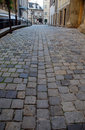 Old european street with cobblestone Royalty Free Stock Photo