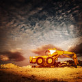 Old excavator on sunset large yellow backhoe make sand pit dramatic background construction and industry concept Royalty Free Stock Photo