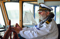 Old experienced captain in navigation cabin Royalty Free Stock Photo