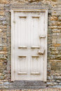 Old external door in a stone wall weathered exterior set buff coloured Stock Photography