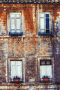 Old facade four windows home. Ancient bricks wall Royalty Free Stock Photo