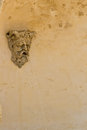 Old face sculpture with water coming out its mouth on a fountain france Stock Photography