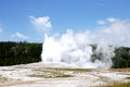 Old faithful an eruption of the geyser in the yellowstone national park usa Stock Photo