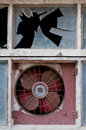 Old fan window with and broken glass Stock Image