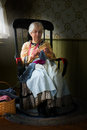 image photo : Old Farm Country Woman Knitting