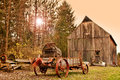 Old farm and farm machinery barn in late autumn Royalty Free Stock Photo