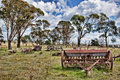 Old farm machinery in field Royalty Free Stock Photo