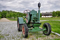 Old farm tractor in rural area Stock Photo