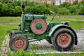Old farm tractor in rural area Royalty Free Stock Image