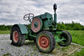 Old farm tractor in rural area Royalty Free Stock Photos