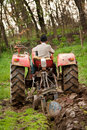 Old farmer plowing Royalty Free Stock Photo