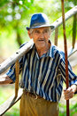 Old farmer with tools Royalty Free Stock Images