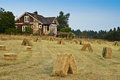 Old Farmhouse with Hay Field Royalty Free Stock Photos