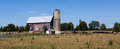Old Farmhouse with silo. Royalty Free Stock Photo