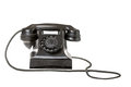 Old-fashioned black rotary telephone Stock Photo