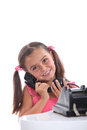 Old fashioned black telephone young girl using an Stock Image