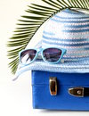 Old fashioned blue suitcase for travel and beach hat Royalty Free Stock Photo