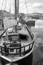 Old fashioned boat in kirwkall harbor orkney islands scotland Stock Photo