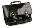 Old fashioned briefcase black shiny leather with gold details and fasteners isolated on white background Royalty Free Stock Photo