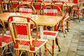 Old fashioned cafe terrace coffee with tables and chairs paris france Royalty Free Stock Image
