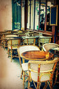 Old fashioned cafe terrace coffee with tables and chairs paris france Stock Photos