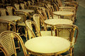 Old fashioned cafe terrace coffee with tables and chairs paris france Stock Photography