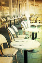 Old fashioned cafe terrace coffee with tables and chairs paris france Royalty Free Stock Photos