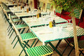 Old fashioned cafe terrace coffee with tables and chairs paris france Stock Photo