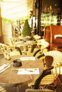 Old fashioned cafe terrace coffee with tables and chairs paris france Royalty Free Stock Images
