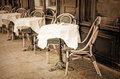 Old fashioned cafe terrace coffee with tables and chairs paris france Royalty Free Stock Photo
