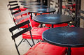 Old fashioned cafe terrace coffee with tables and chairs paris france Royalty Free Stock Photography