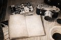 Old fashioned camera opened book cup of coffee artwork in retro style empty Royalty Free Stock Image