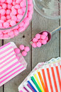 Old fashioned candy jar full of pink peppermints being distributed into individual candy bags Royalty Free Stock Images