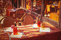 Old fashioned coffee terrace with tables and chairs paris france street view of a Stock Photo