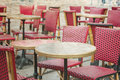 Old fashioned coffee terrace with tables and chairs paris france street view of a Royalty Free Stock Images