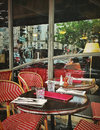 Old fashioned coffee terrace with tables and chairs paris france street view of a Stock Photography