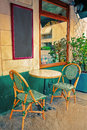Old fashioned coffee terrace with tables and chairs paris france street view of a Stock Image