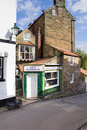 Old fashioned english shop street in robin hood s bay england Royalty Free Stock Photography
