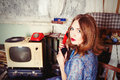 Old fashioned girl speaking telephone in ussr style Royalty Free Stock Photo