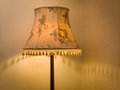 Old fashioned lampshade with tassels in corner of room Stock Photo