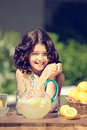 Old fashioned lemonade stand with little girl Stock Photography
