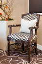 Old fashioned luxurious armchair with squared upholstery Royalty Free Stock Photo