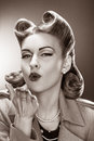 Old-fashioned Pin-up Girl Blowing a Kiss. Retro Style Royalty Free Stock Photo