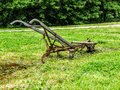 Old fashioned plough in a field