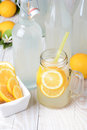 Old fashioned sparkling lemonade shot from a high angle vertical format on a rustic wooden farmhouse style table Royalty Free Stock Images