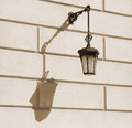 Old fashioned street lamp with shadow fashion on the building wall Stock Photo
