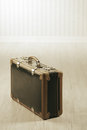 Old fashioned suitcase alone in a room or station Royalty Free Stock Images